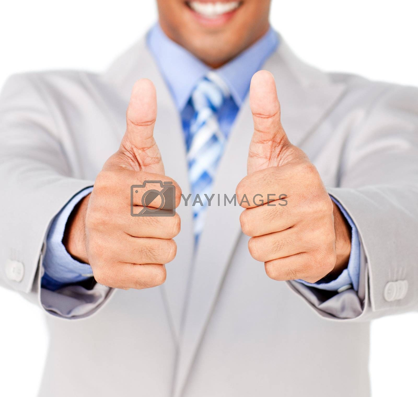 Close-up of a businessman with thumbs up in celebration isolated on a white background