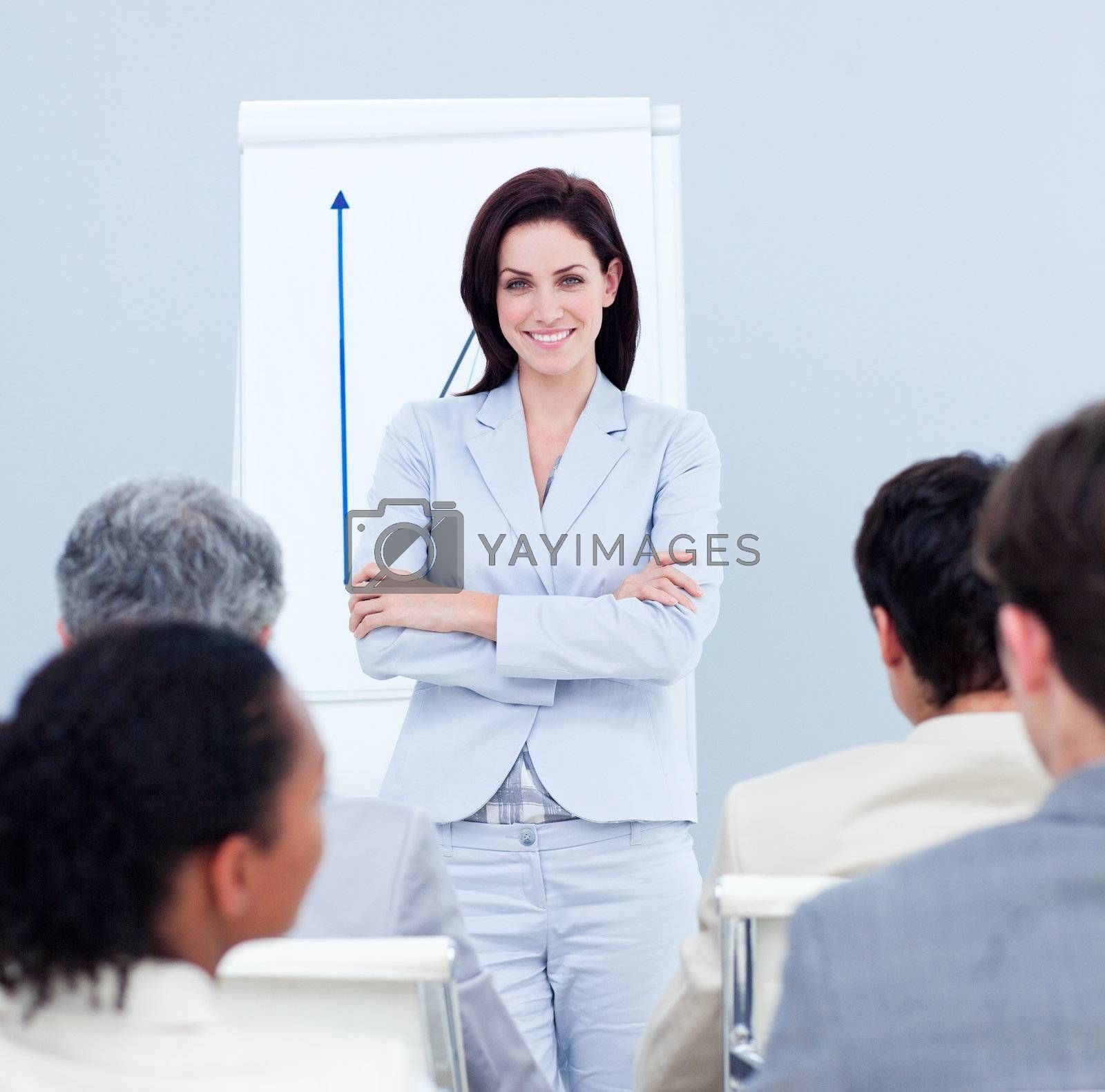Positive businesswoman doing a presentation to her colleagues