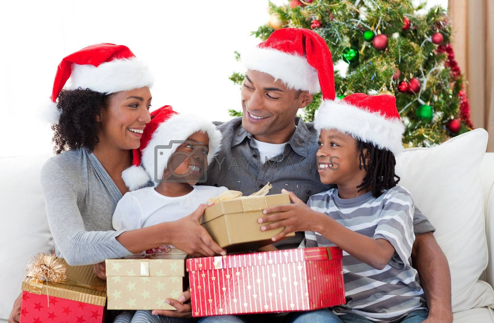 Happy Afro-American family celebrating Christmas at home