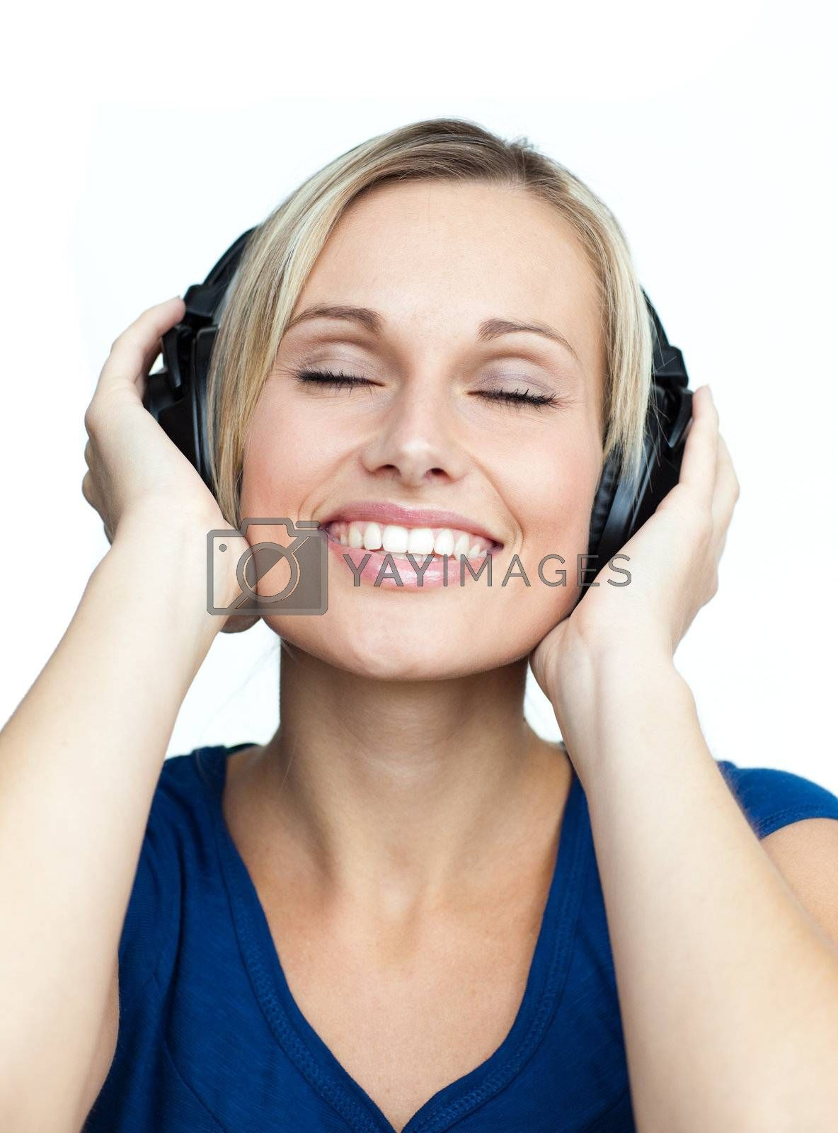Close-up of young woman listening to music with headphones on