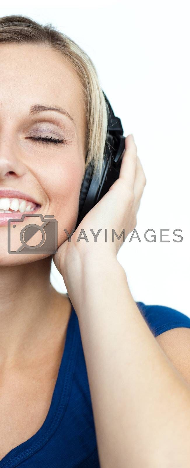 Close-up of young woman listening to music and closed eyes