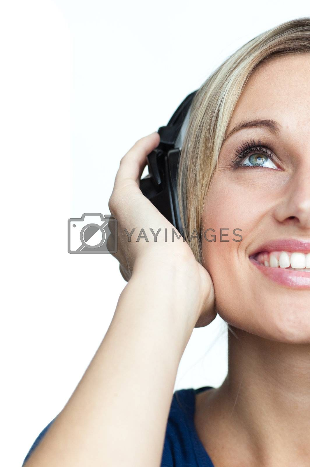 Happy girl woman listening to music on headphones