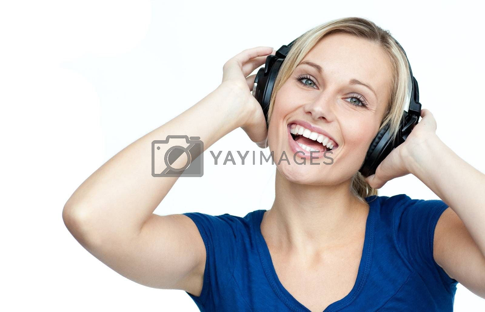 Happy young woman listening to music with headphones on
