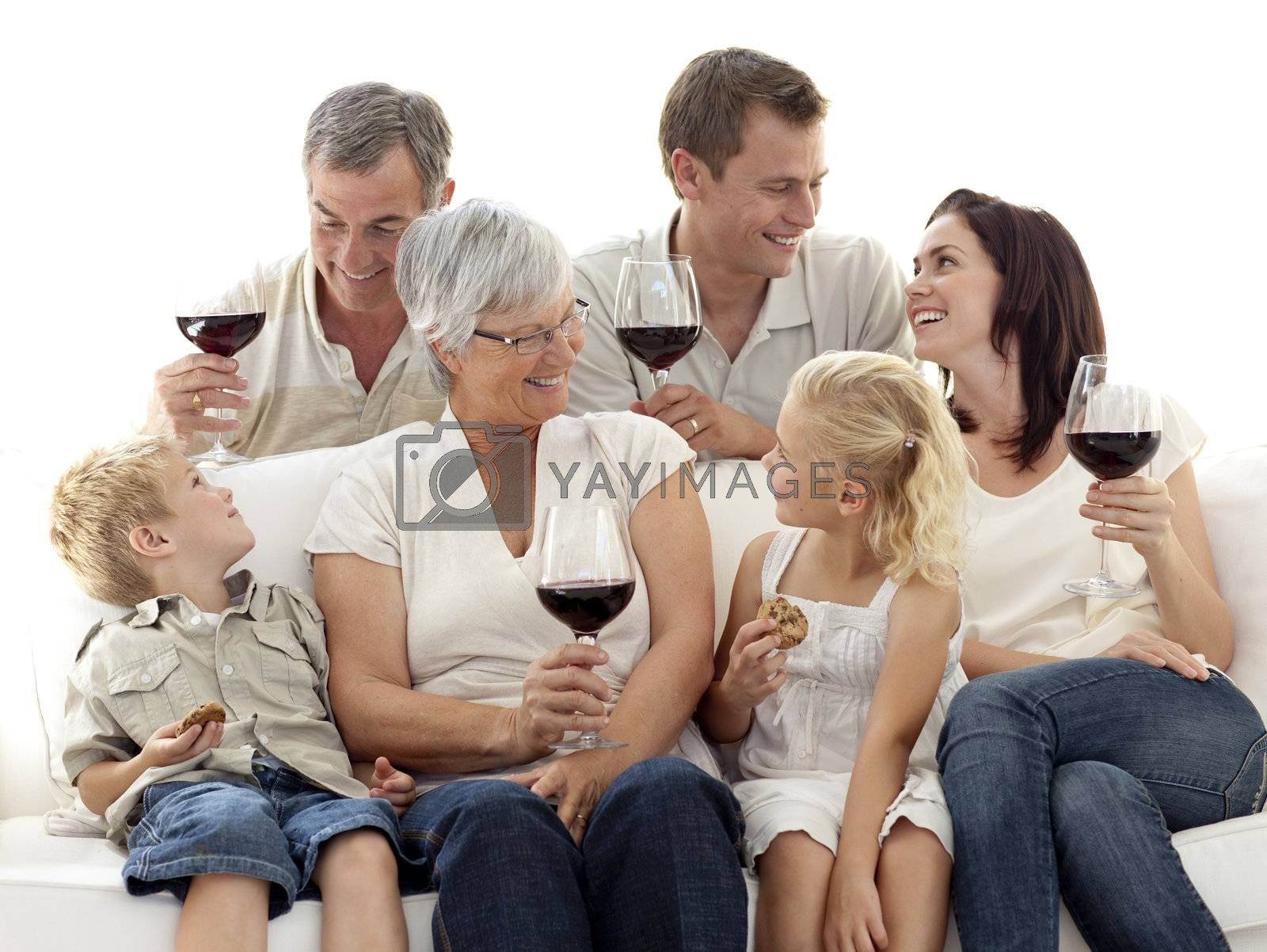 Happy family having a celebration with wine and eating biscuits