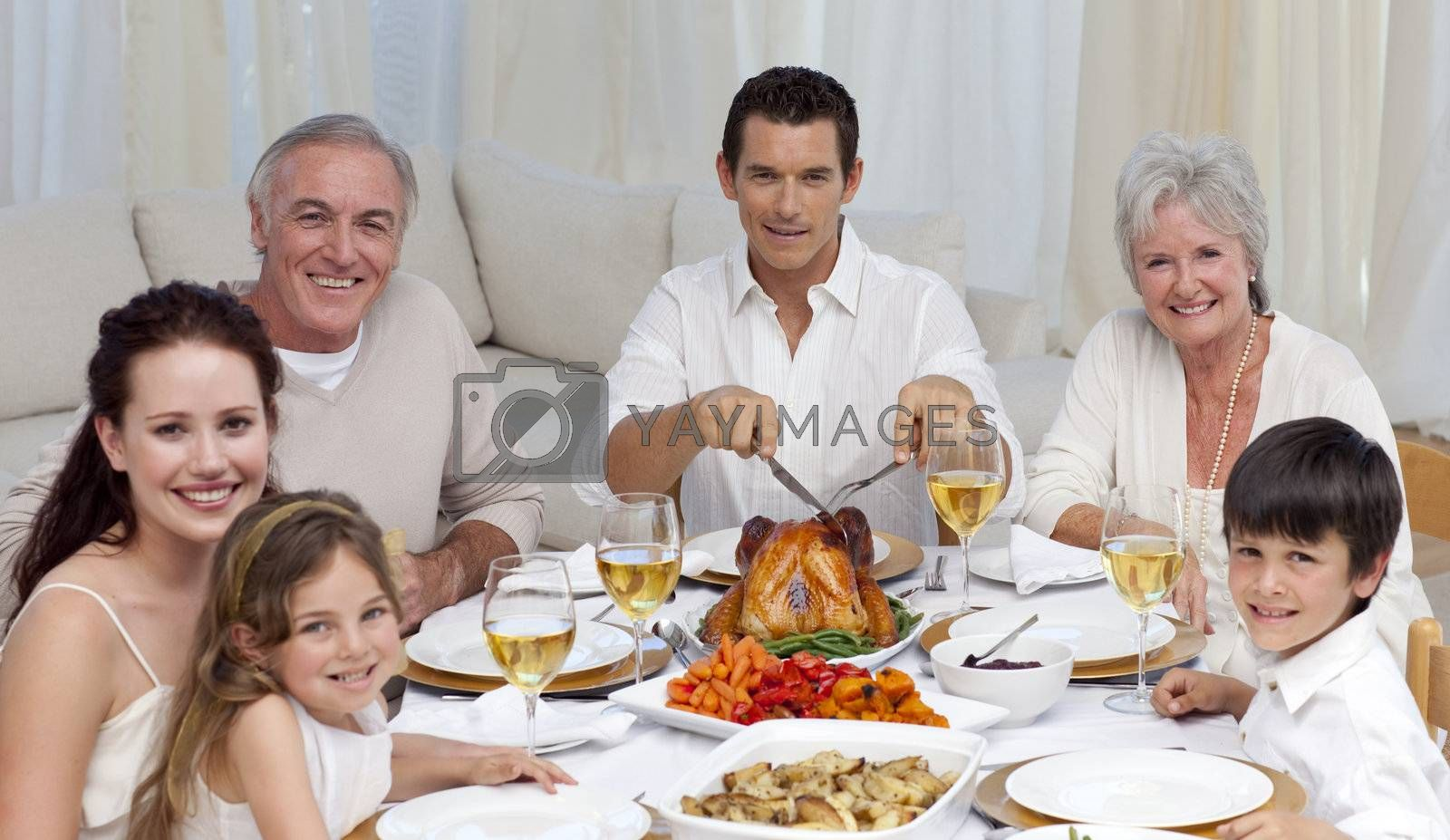 Family eating turkey and vegetables in a celebration meal at home