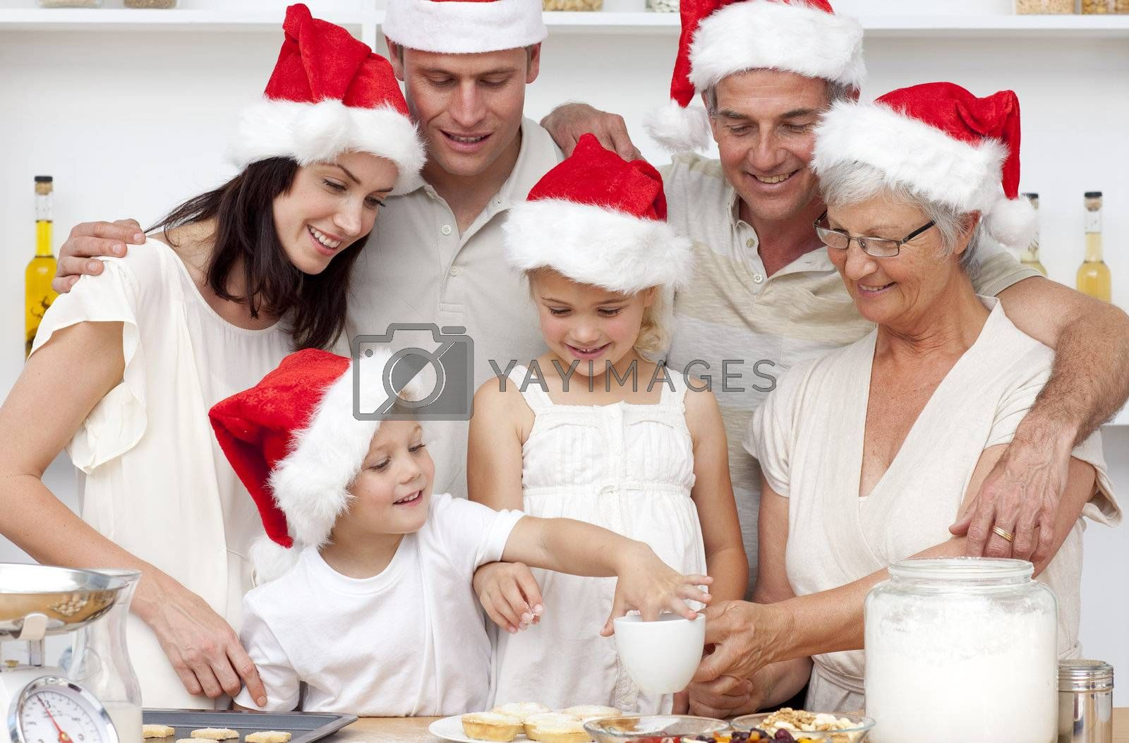 Happy family baking Christmas cakes and sweets in the kitchen
