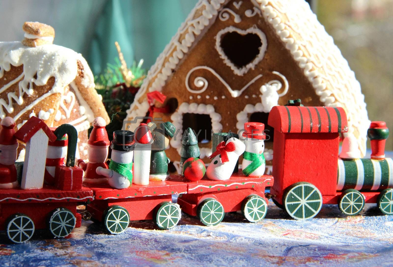 Christmas baked sweet houses and toy train with funny passengers