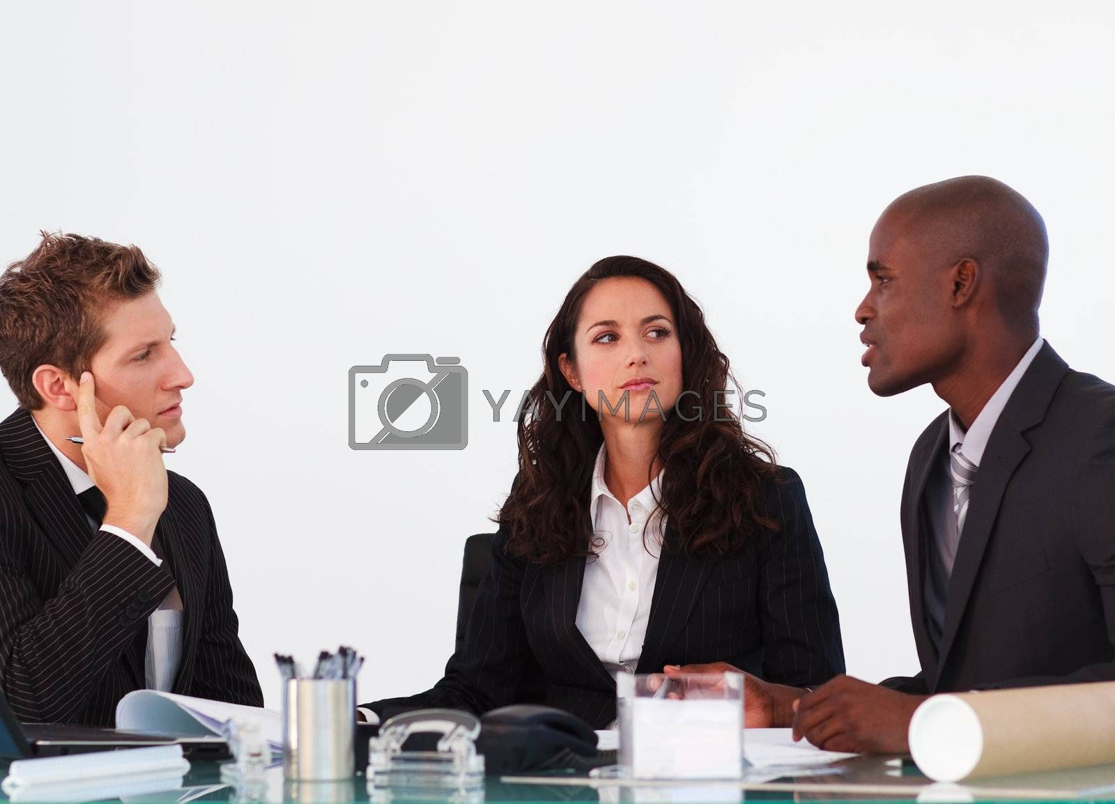 Three business people interacting in a meeting by Wavebreakmedia