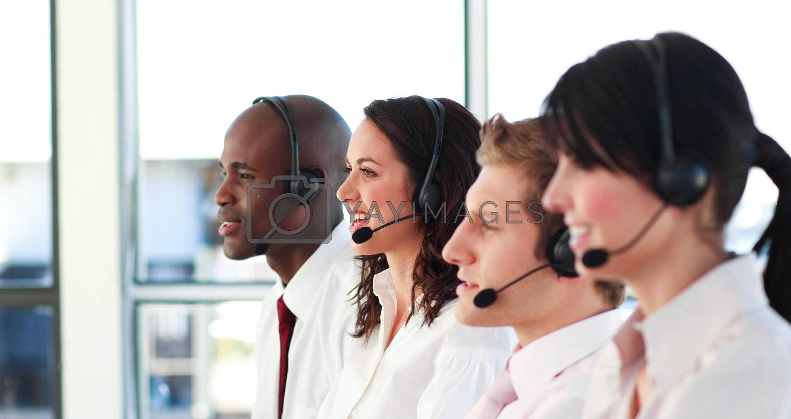 Young people with a headset on working in a call center