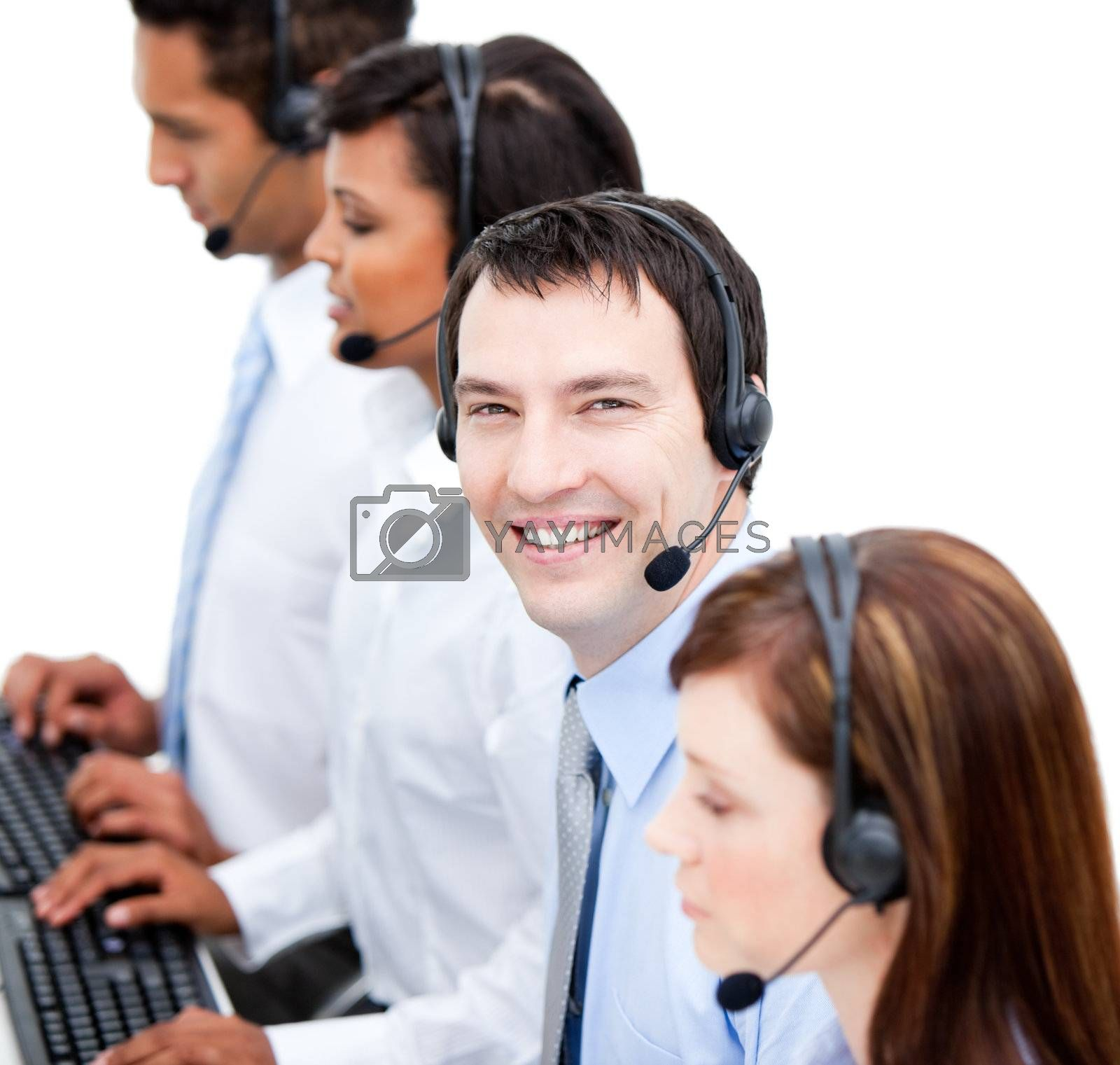 Portrait of smiling business team with  headset on against white background