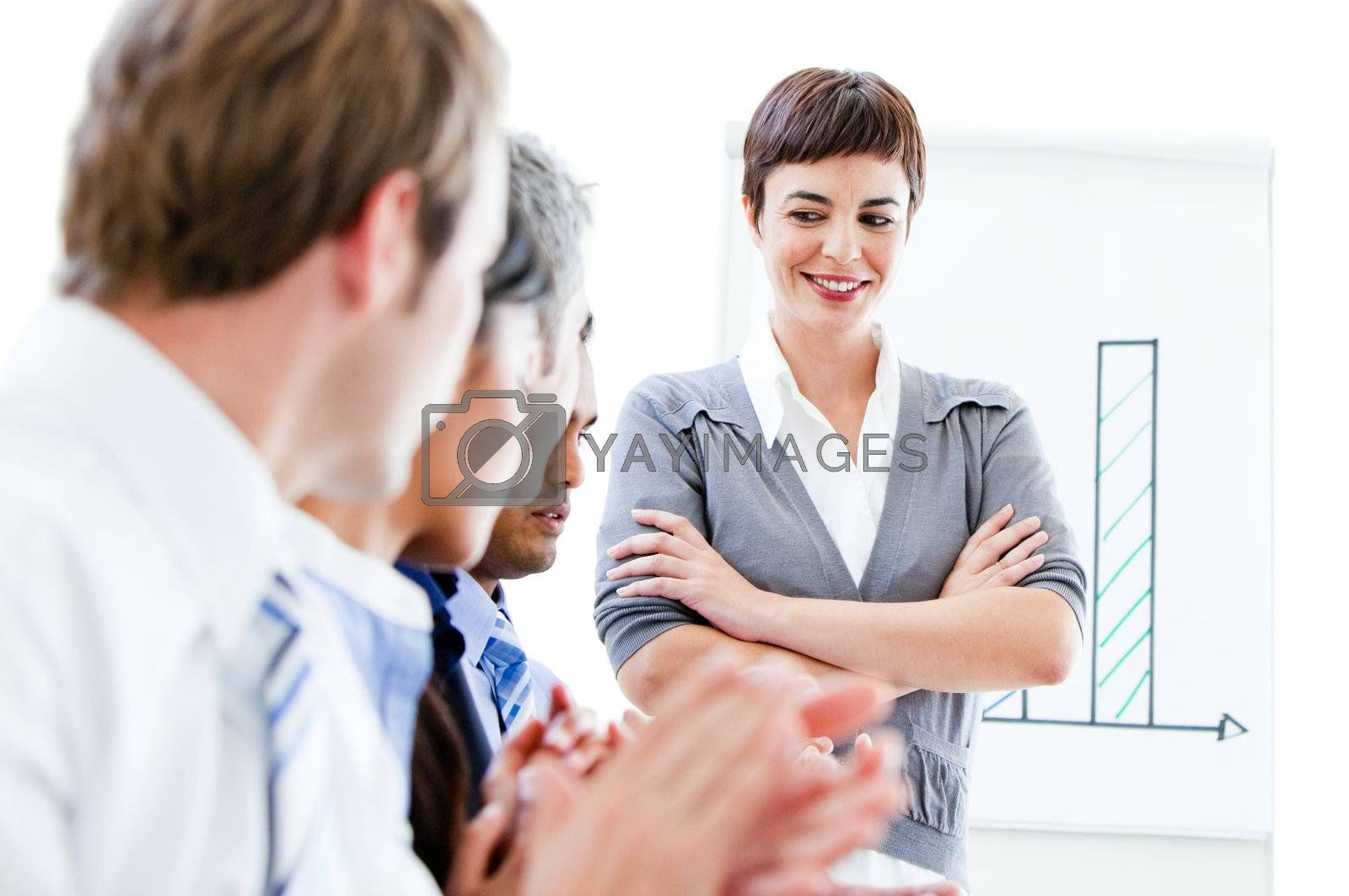 Portrait of a confident businesswoman looking at her colleague during a meeting in the office