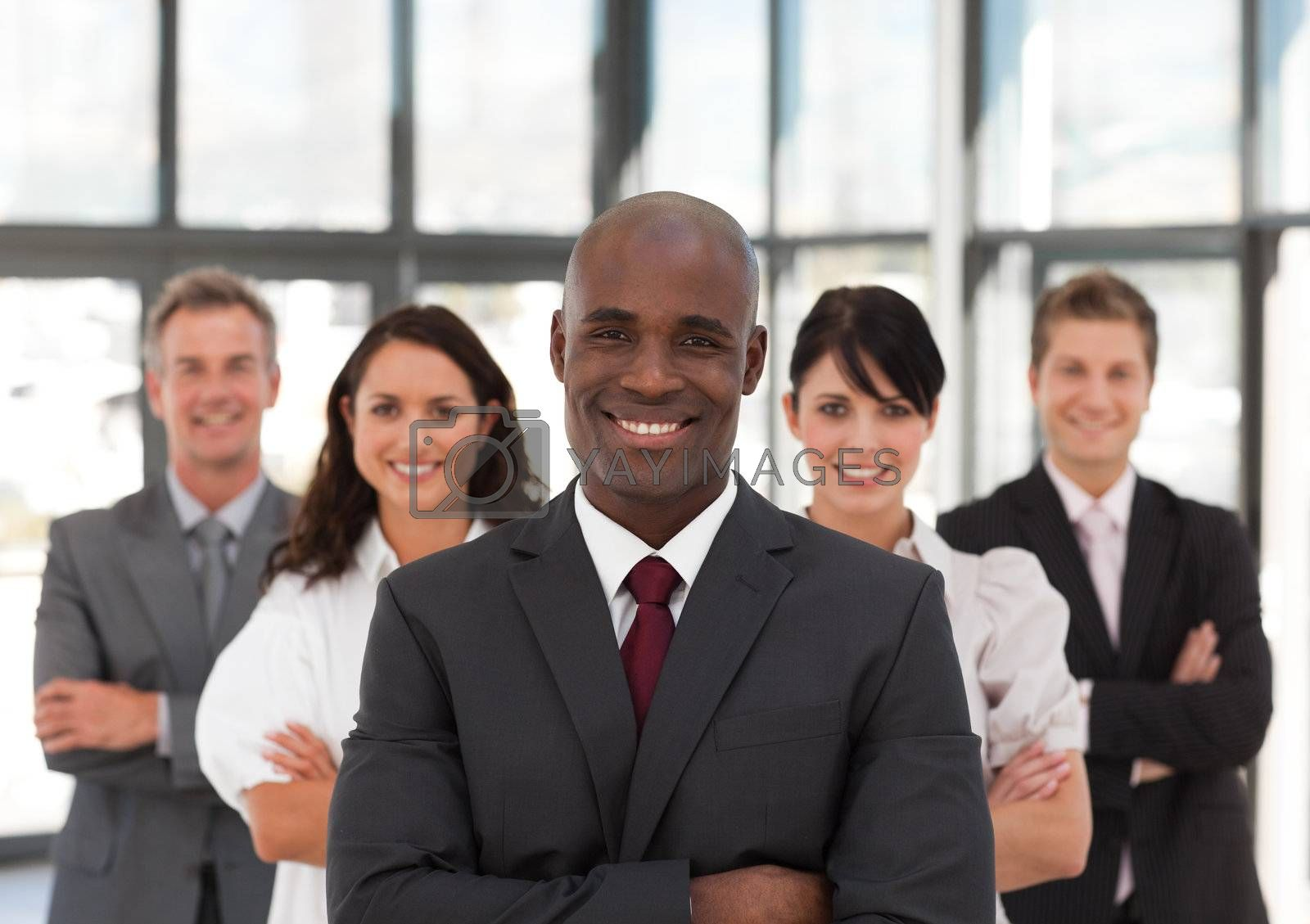 Smiling confident business team looking at the camera in a office