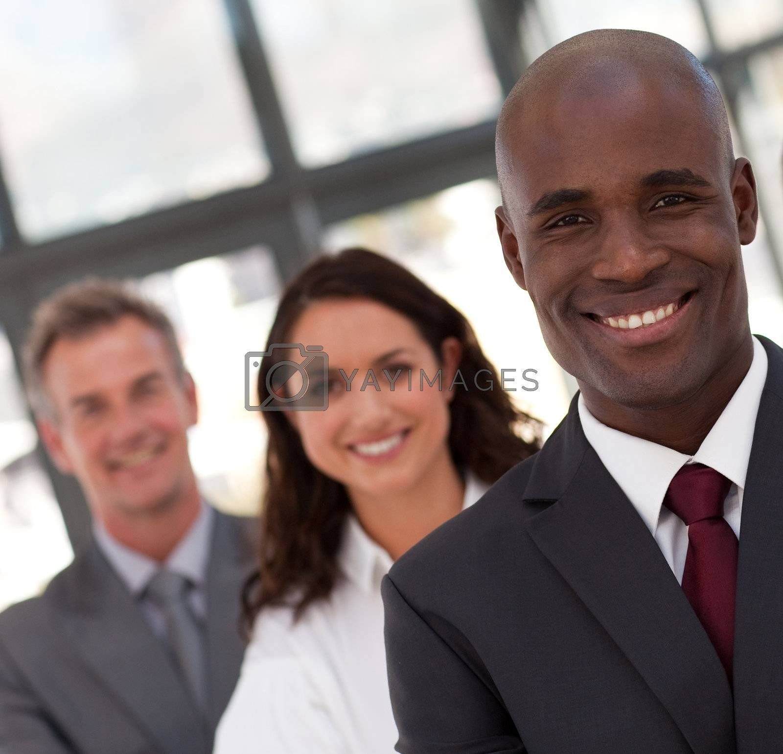Young confident business team looking at the camera in a office