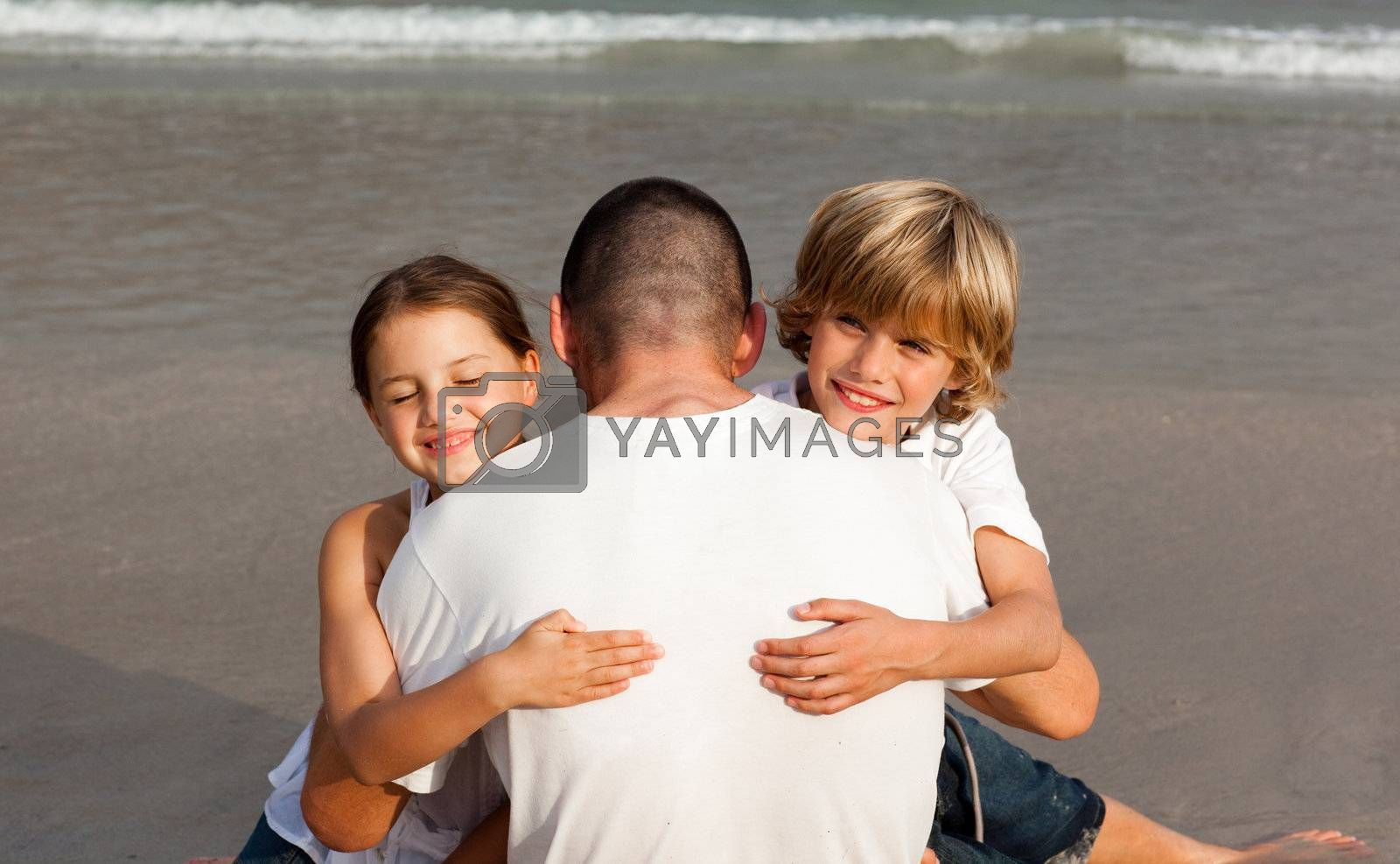 United Family on the beach having fun together