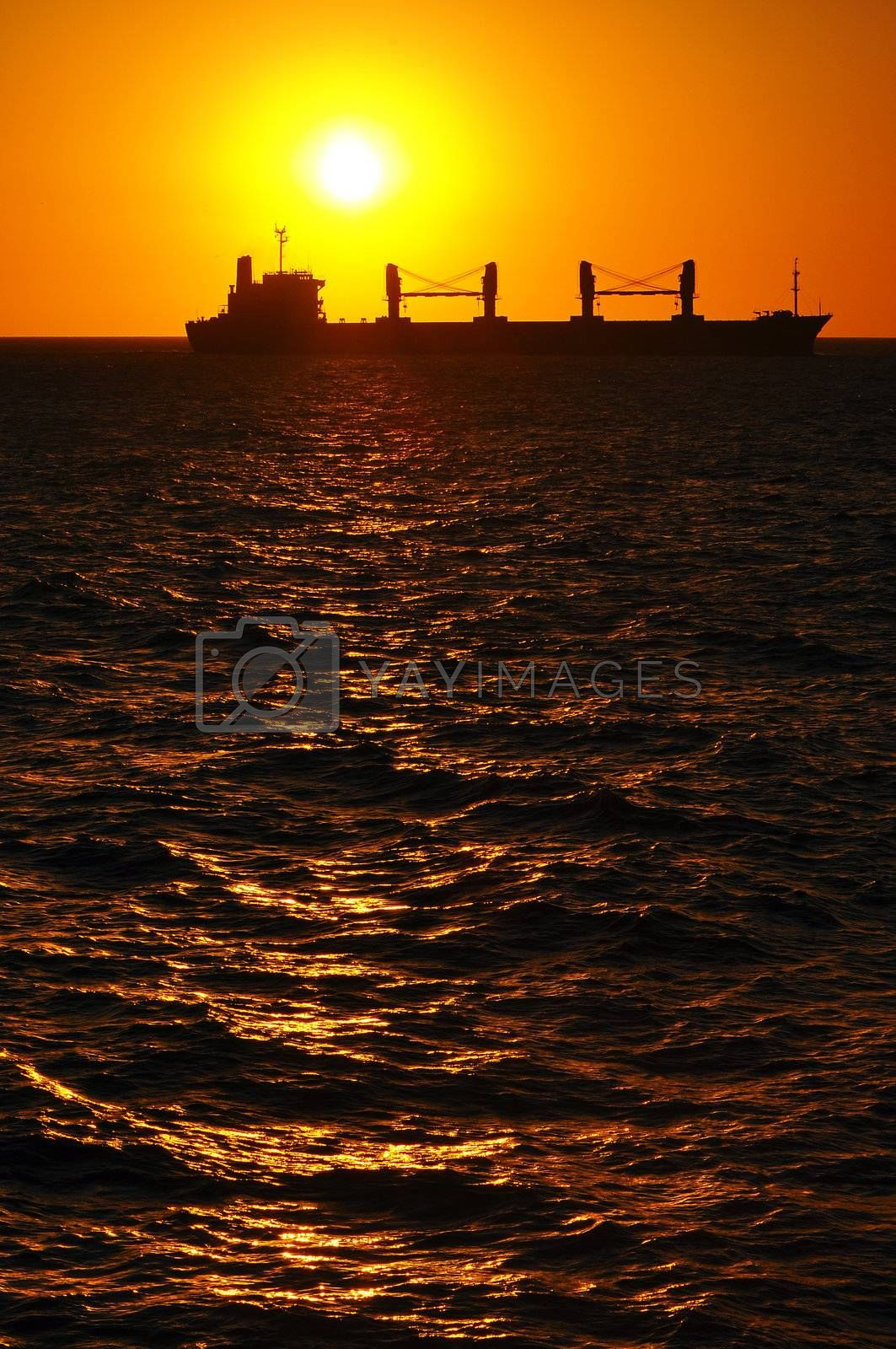 A silhouette of a boat at sunset in Montevideo, Uruguay.