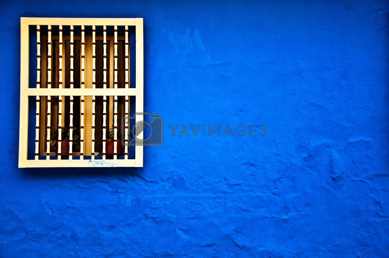 A colonial styled window and wall in the historical center of Bogota, Colombia.