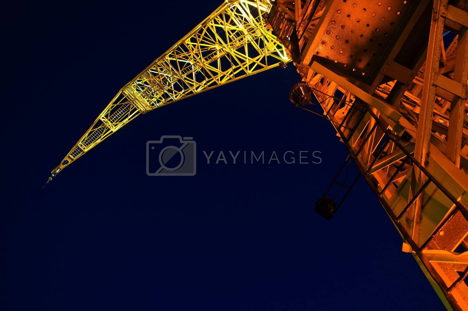 A yellow and orange crane at night in Buenos Aires.