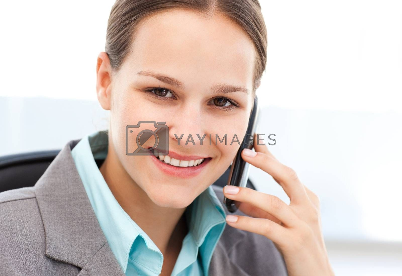 Young businesswoman on the phone with her cellphone in her office
