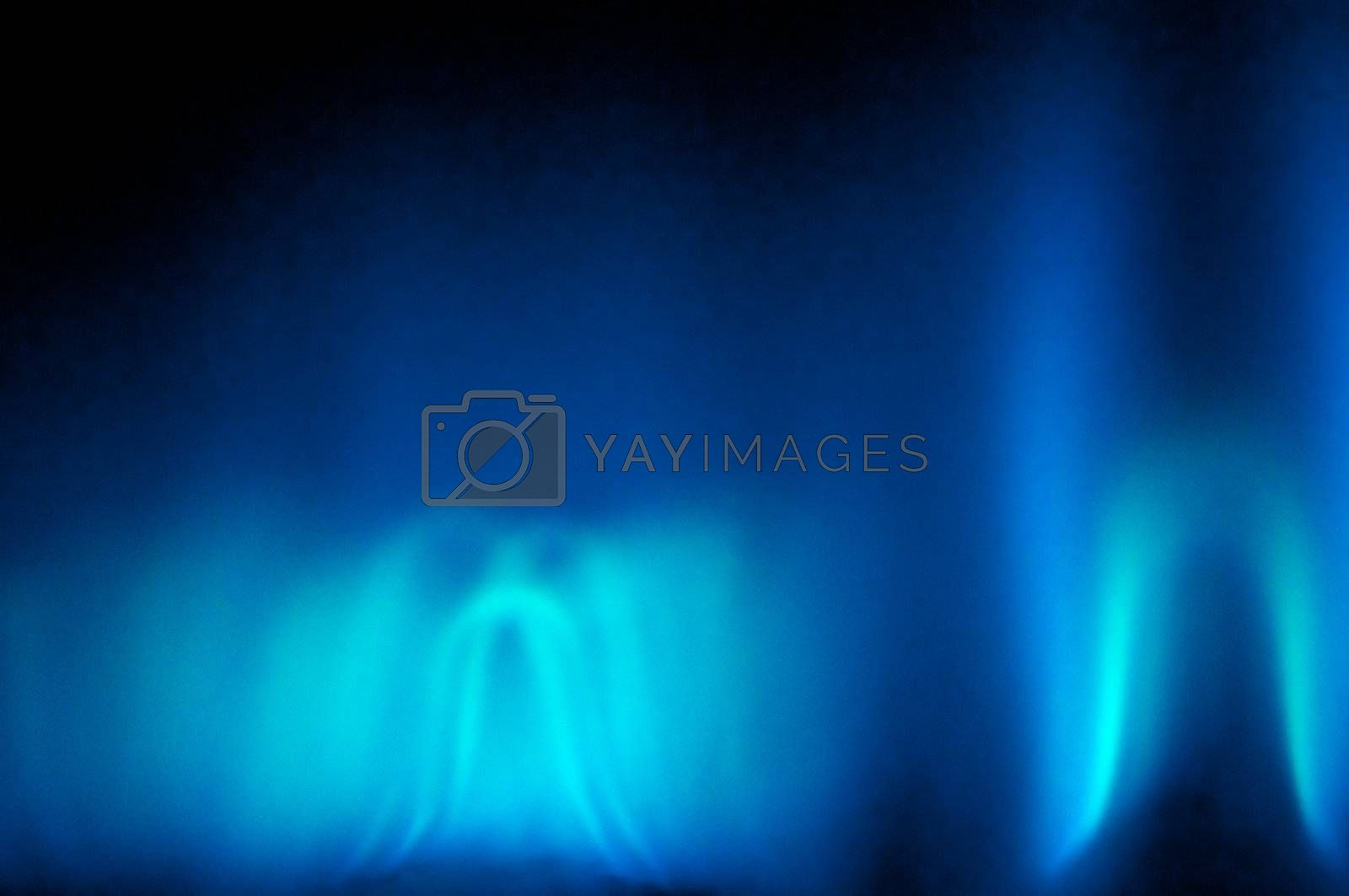 An abstract shot of the blue flame of a gas heater.