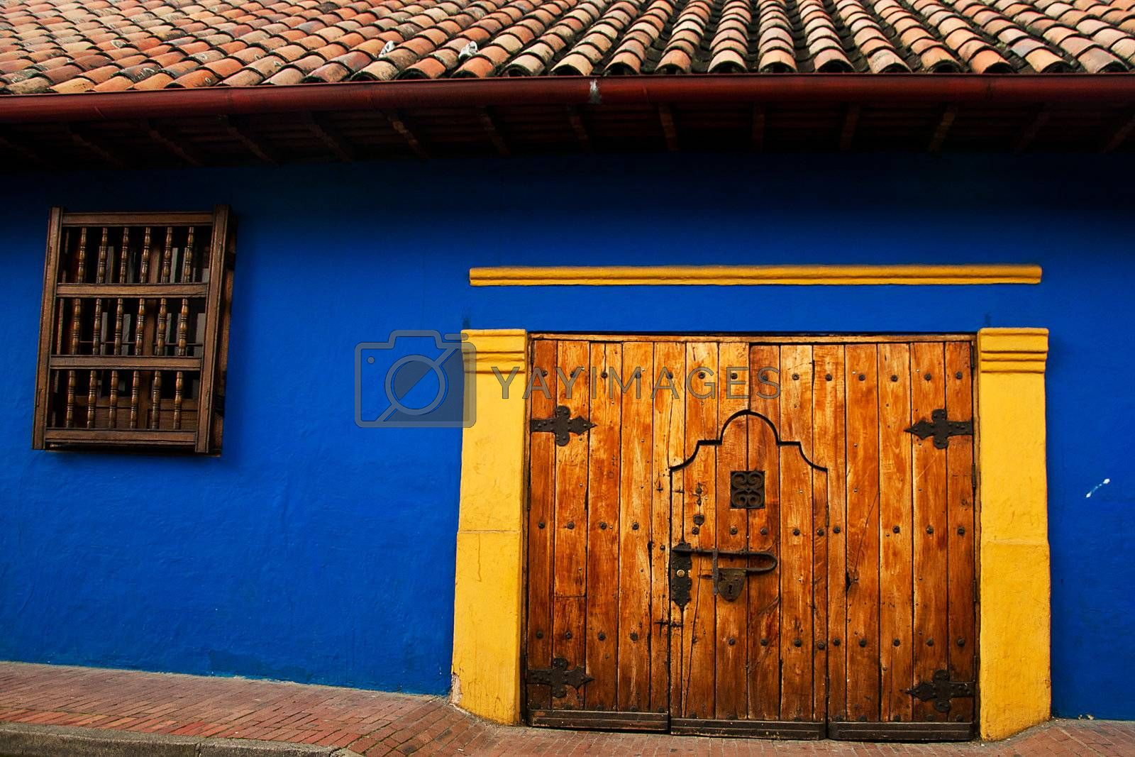 Blue wall in the Spanish colonial style in the neighborhood La Candelaria in Bogota, Colombia.
