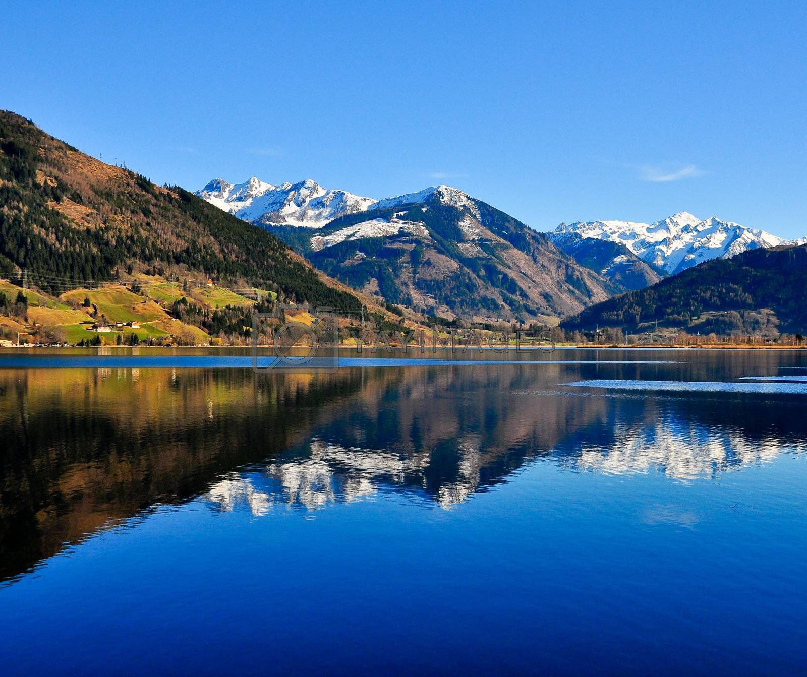 Blue mountain lake landscape view with mountain reflection, Zell am See, Austria