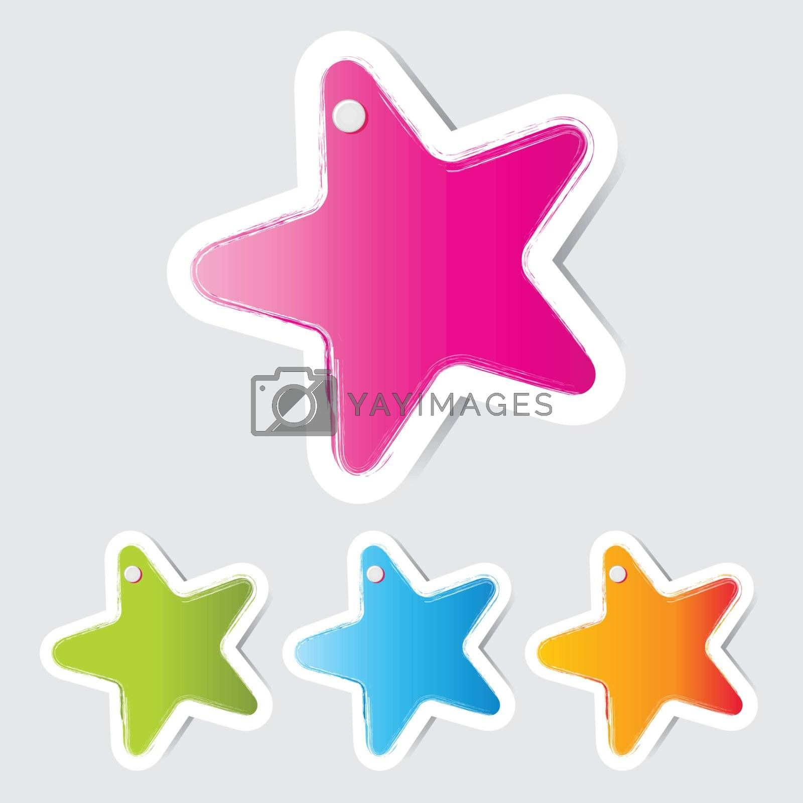 Colorful paper star with a stick pin