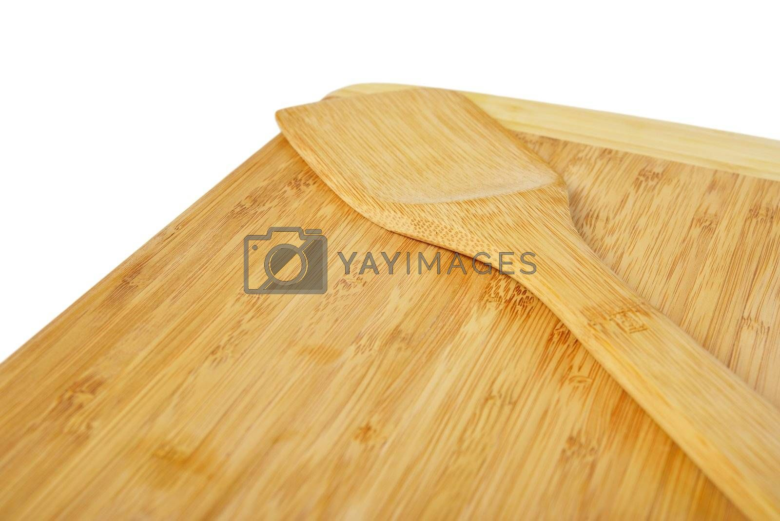 Wooden kitchen board with a spatula. Isolated on white background.