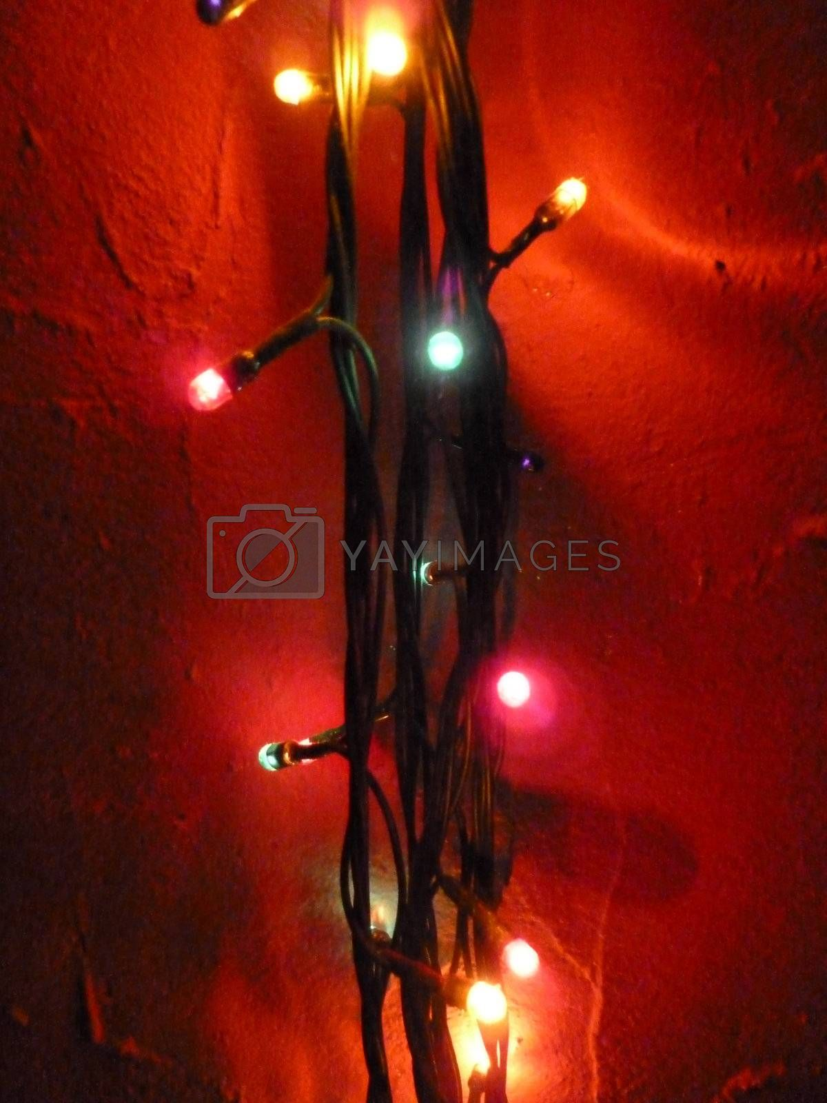 string of lights on a red background