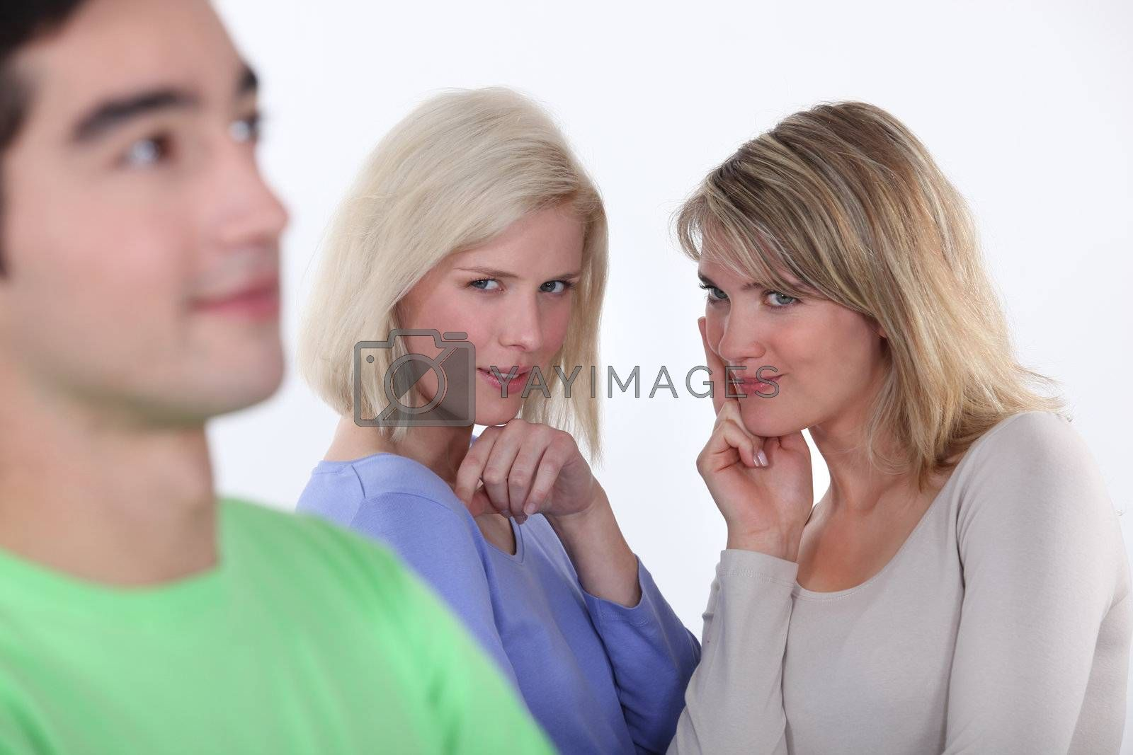 Young women observing a man