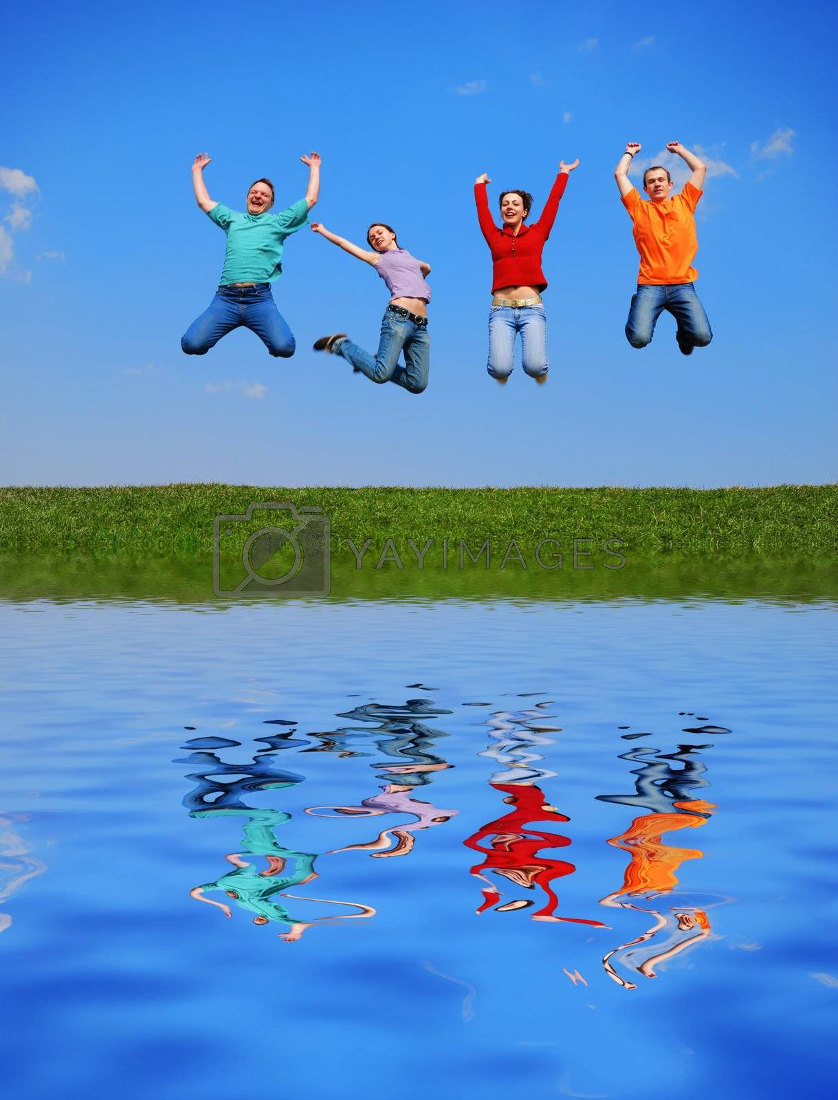 People jumping against blue sky with reflection on water