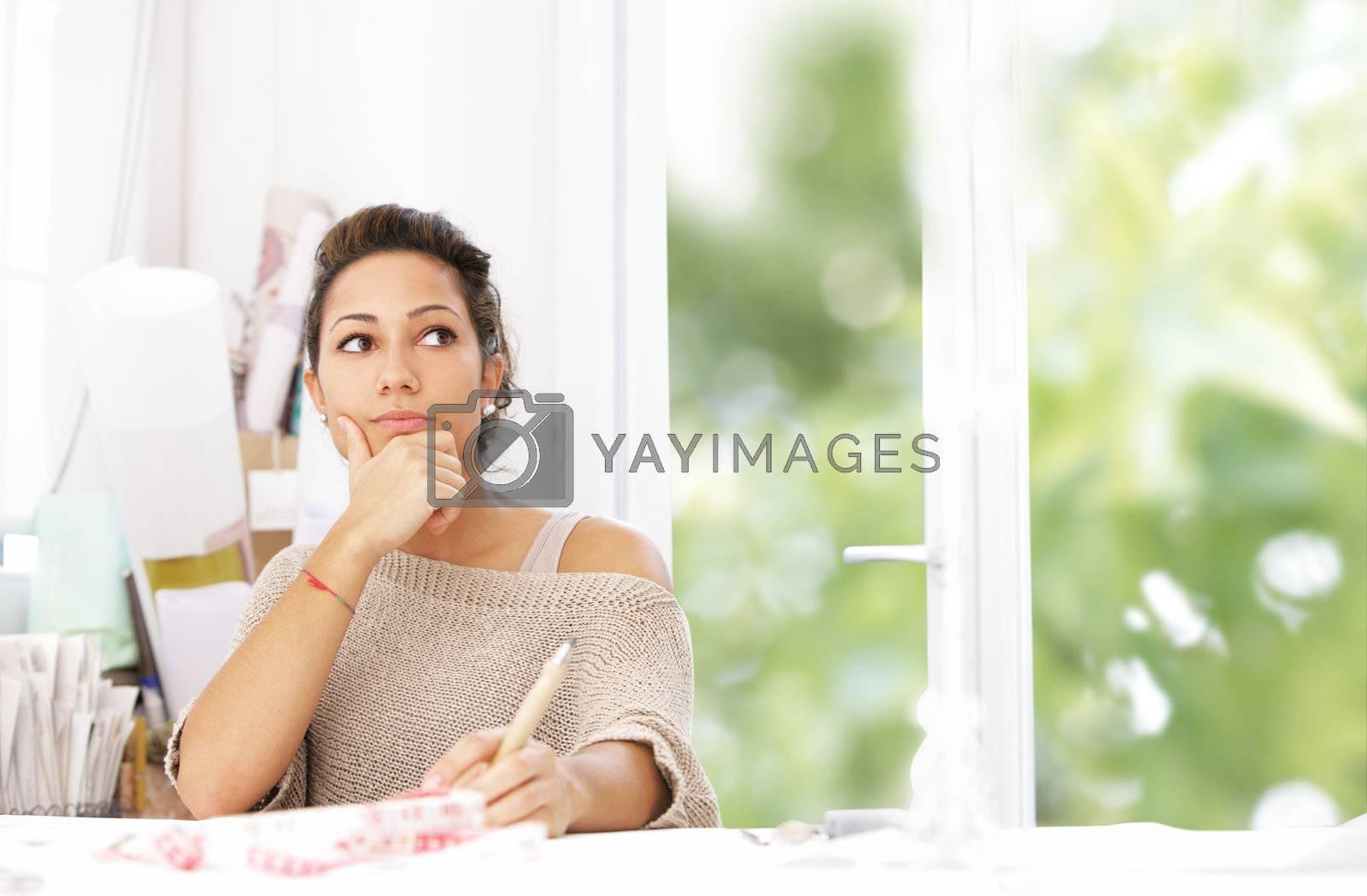 Fashion designer thinking by stokkete