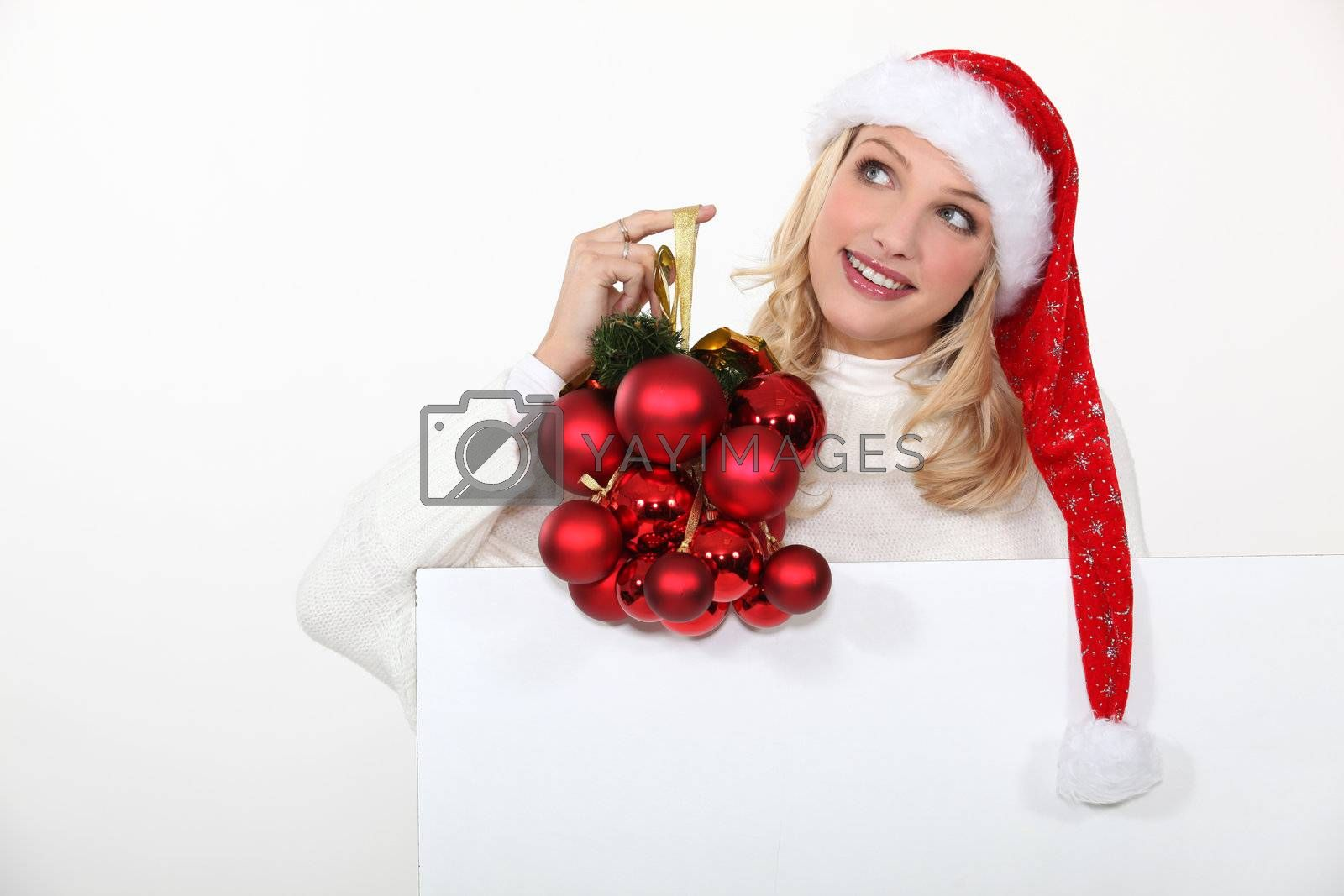 Woman holding Christmas ornaments