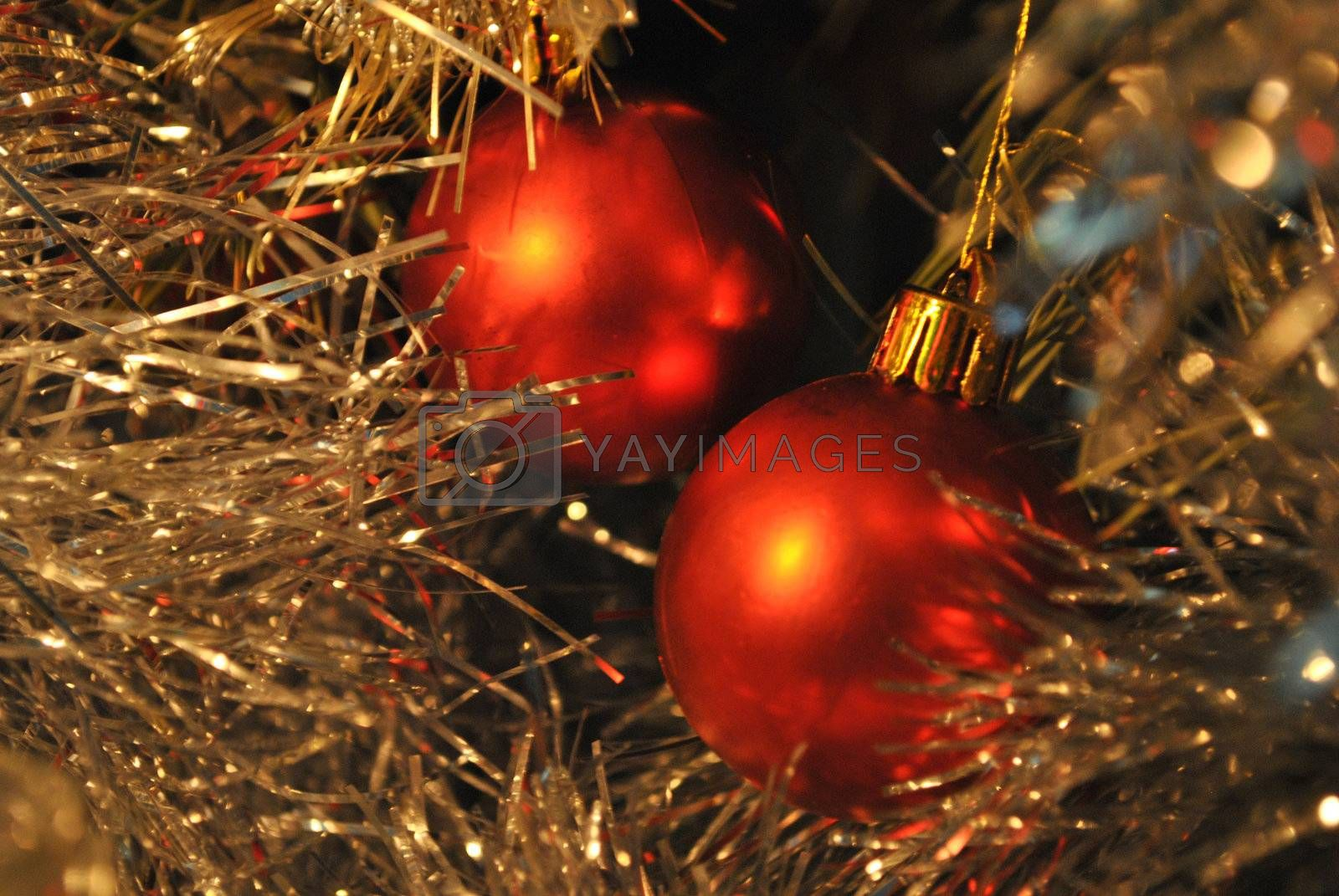 Festive red balls with tinsel