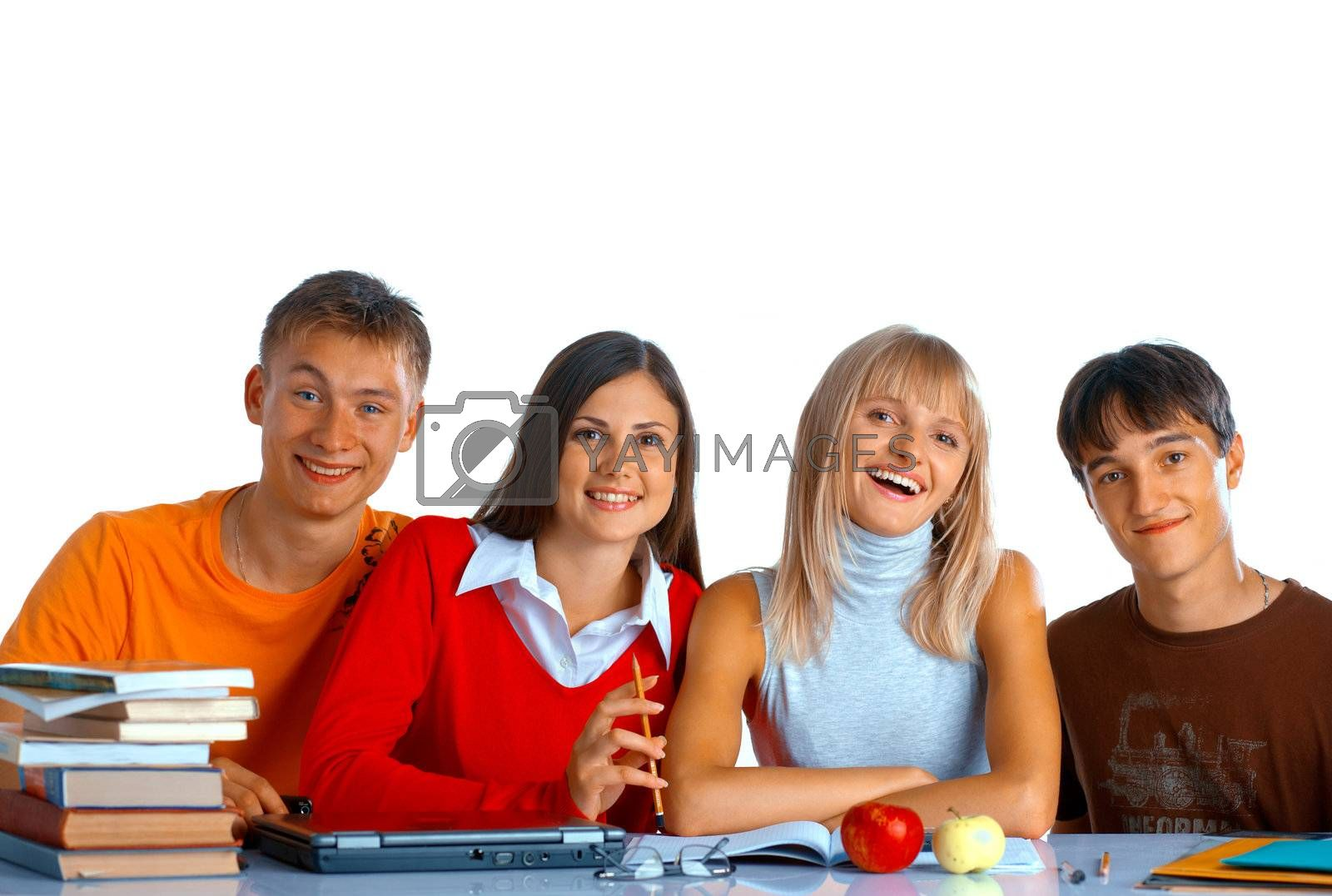 Group of students sit at the desk and smile on white background