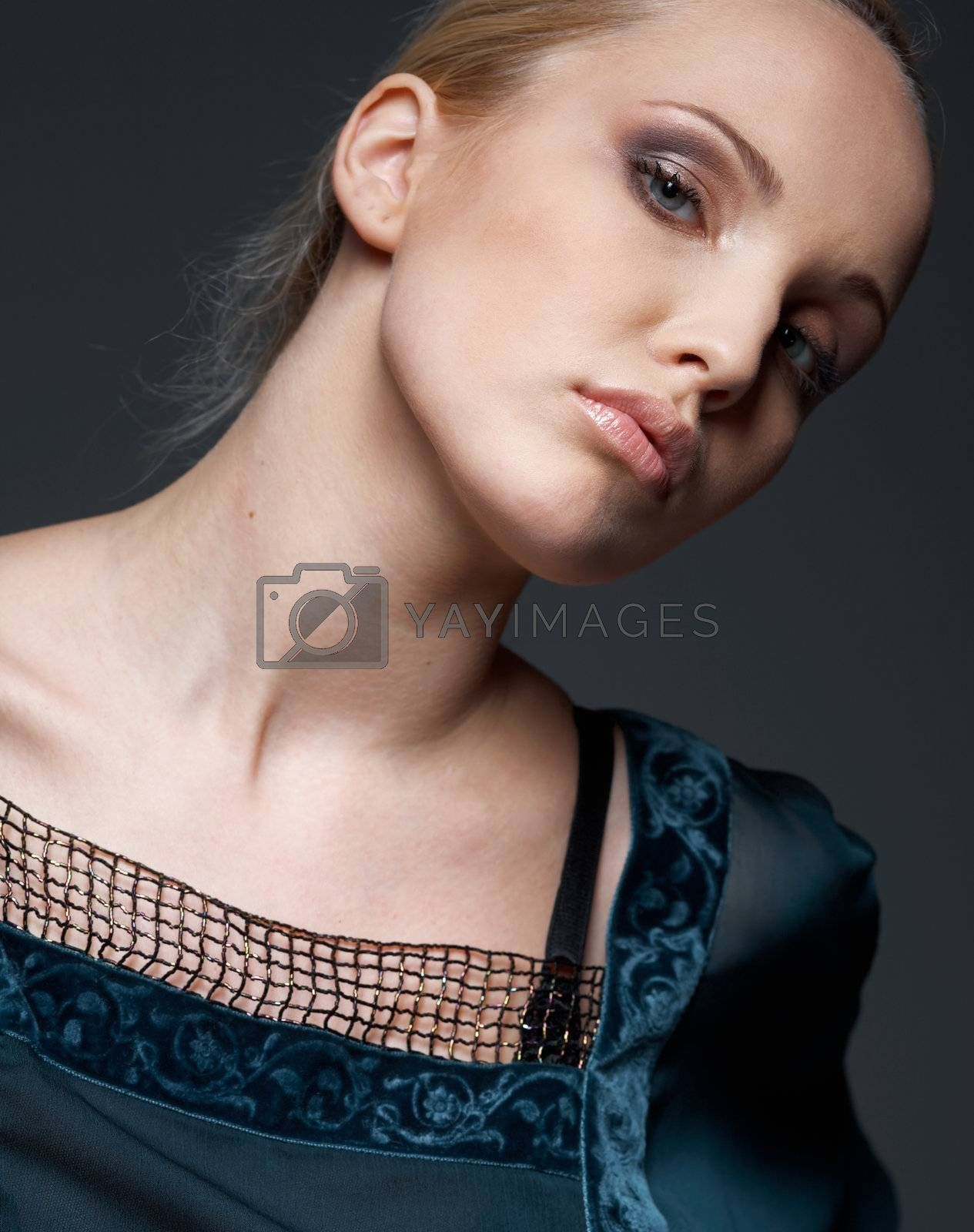 Close-up portrait of a beautiful model dressed in vintage blouse, posing.