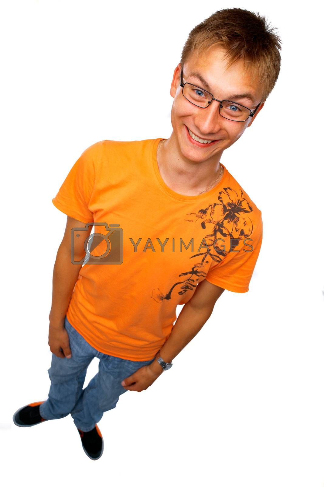Full length of a happy young guy standing on white