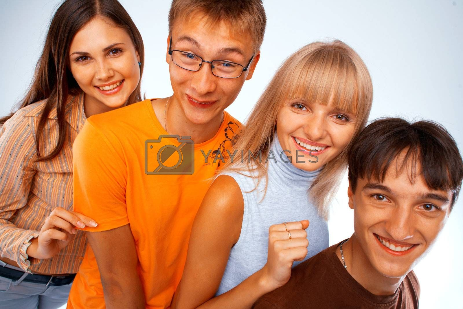 Young friends laughing together standing in a row