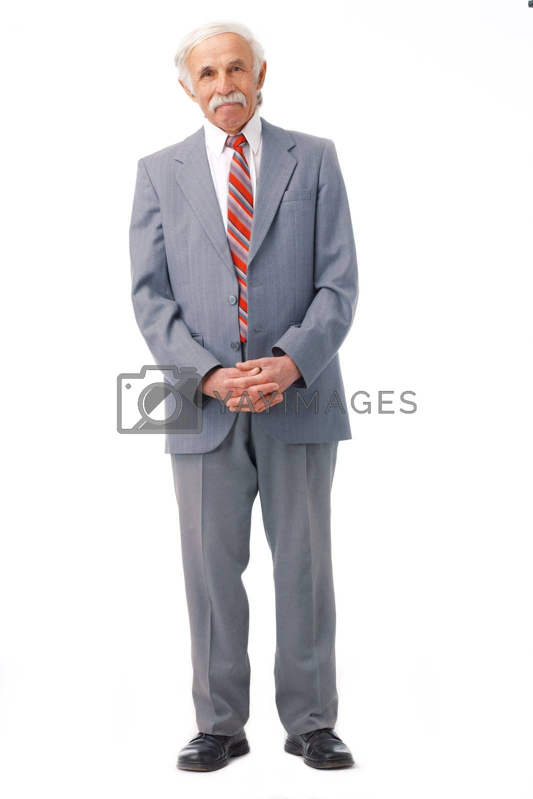 Full length portrait of an elder man standing over white.