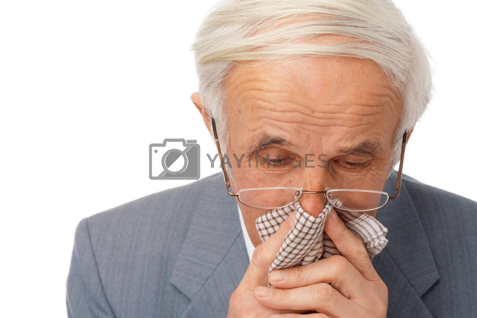 Portrait of an elder man using his handkerchief over white.