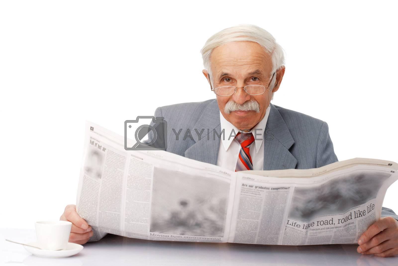 Portrait of an elder happy man reading a newspaper