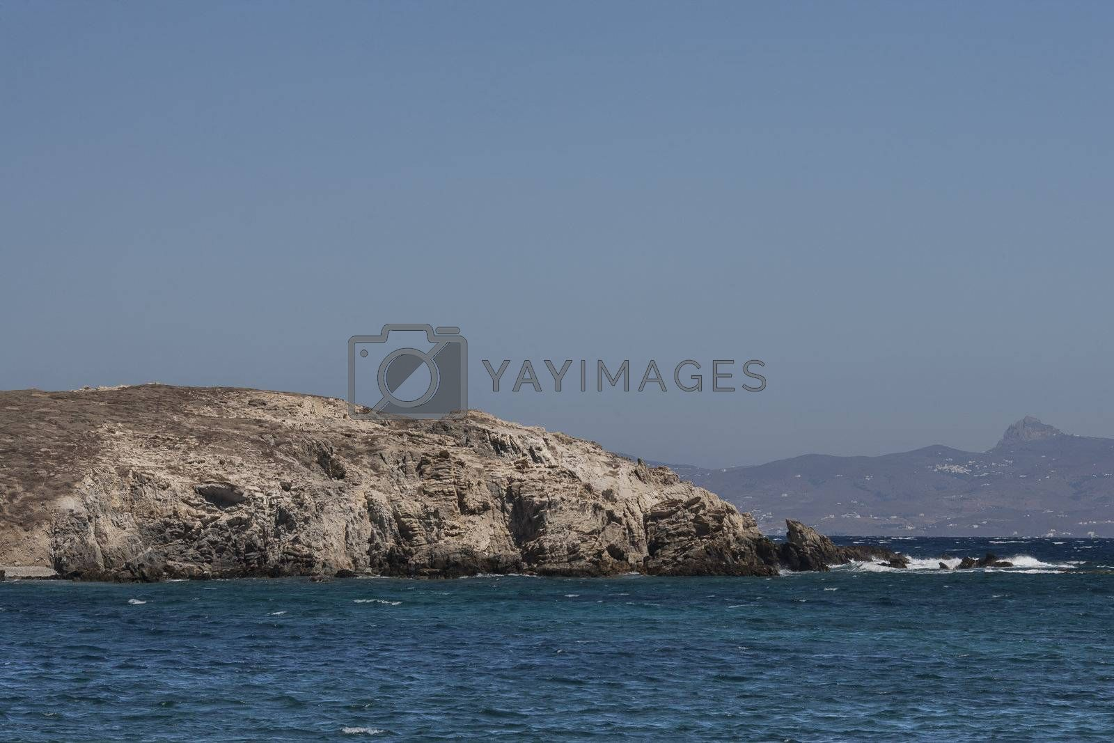 cliff with sea in foreground delos greece