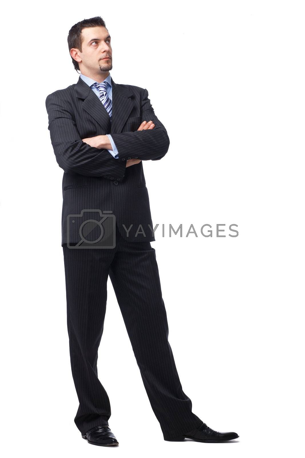 Portrait of a business man with hands folded looking away in a thought  on white