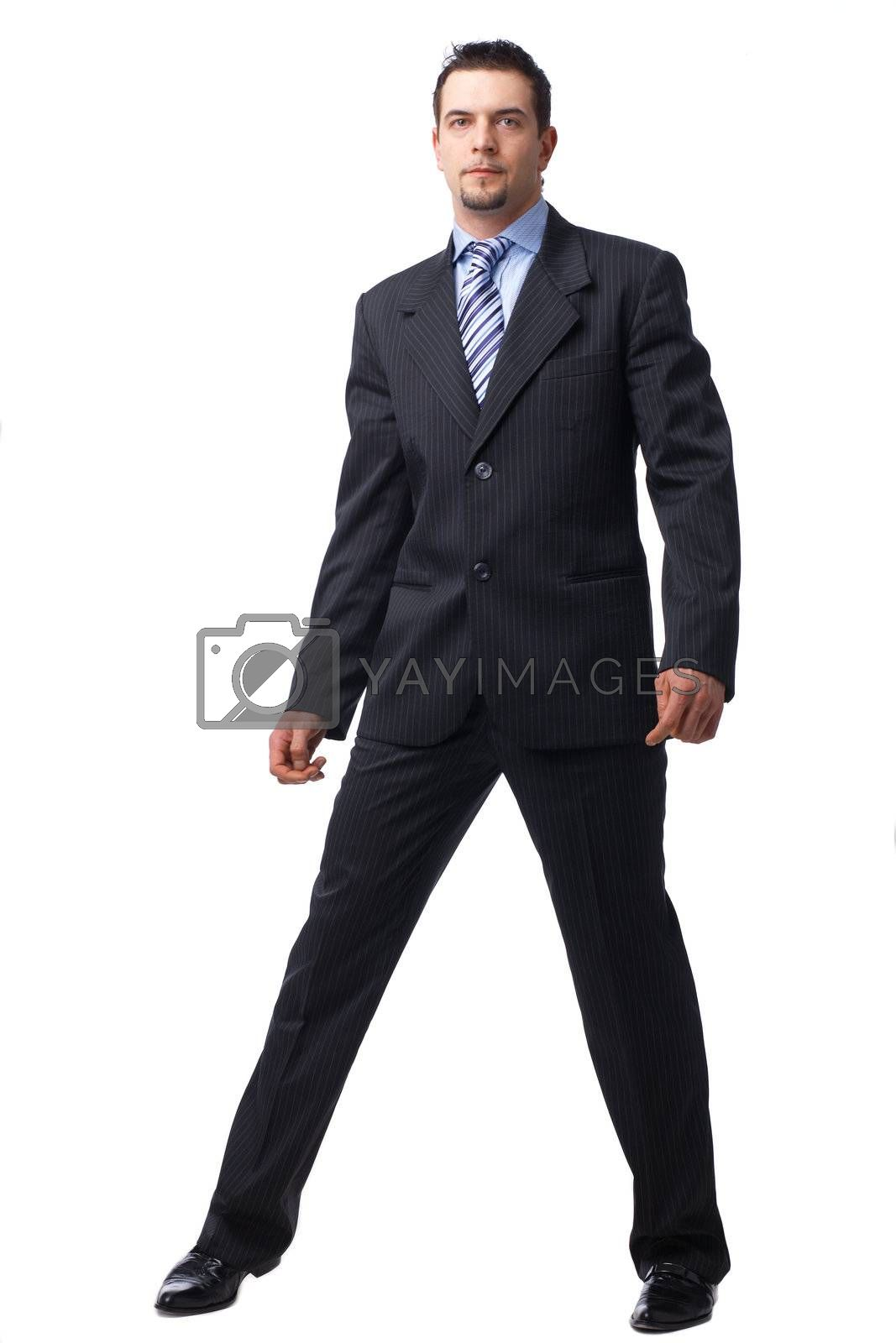 Portrait of a confident young businessman standing over white background.