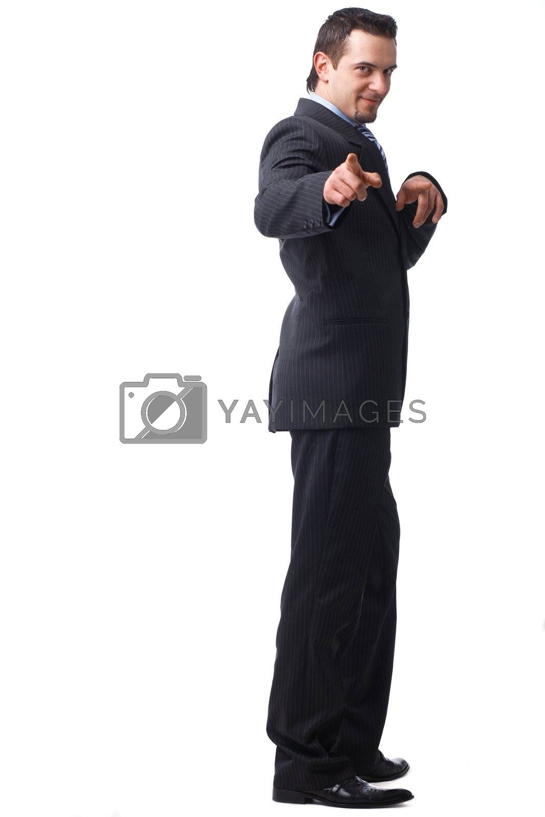 Full length portrait of business man pointing to you with both hands over white background