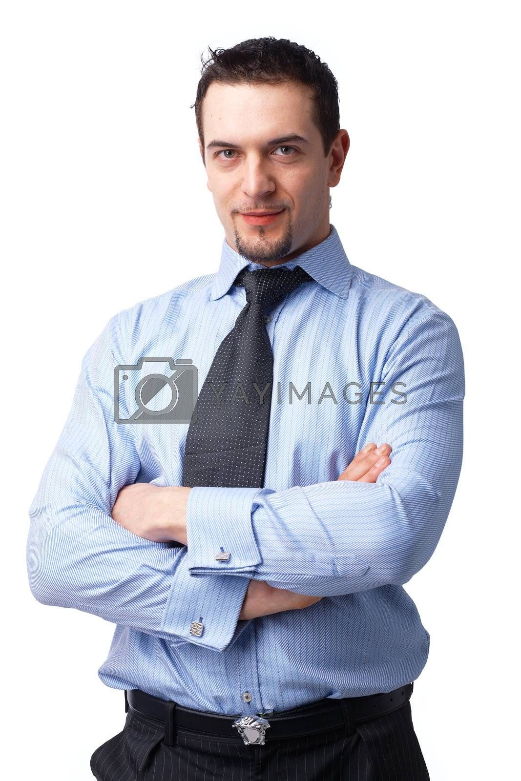 Portrait of successful businessman, smiling with his hands folded over white background.