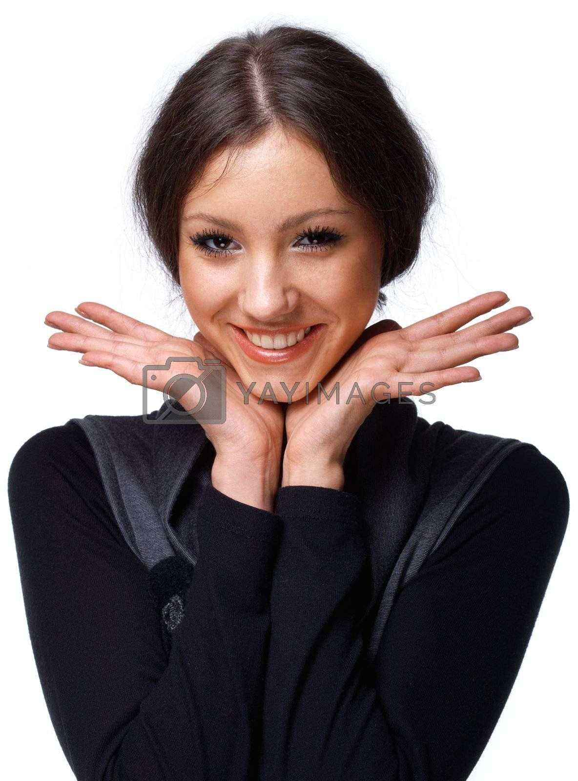 Portrait of a beautiful happy young girl, holding her open palms under her chin.