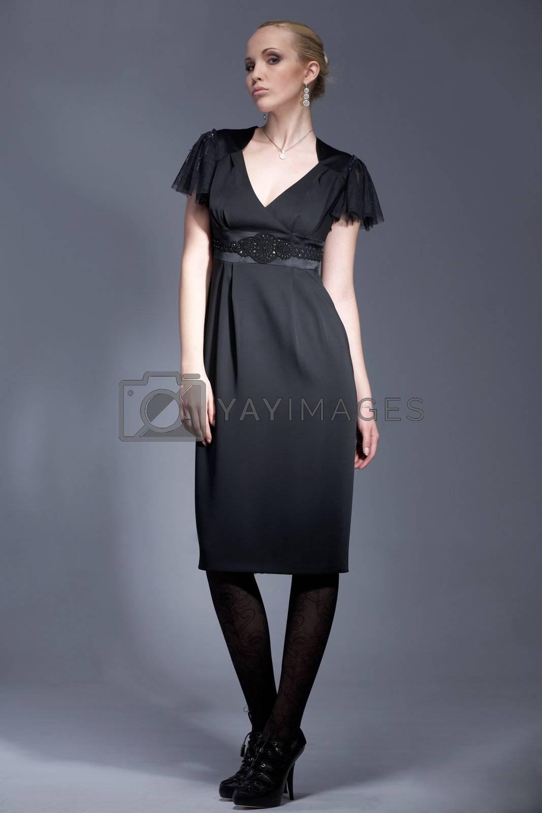 Portrait of a beautiful model dressed in black, vintage dress, posing.