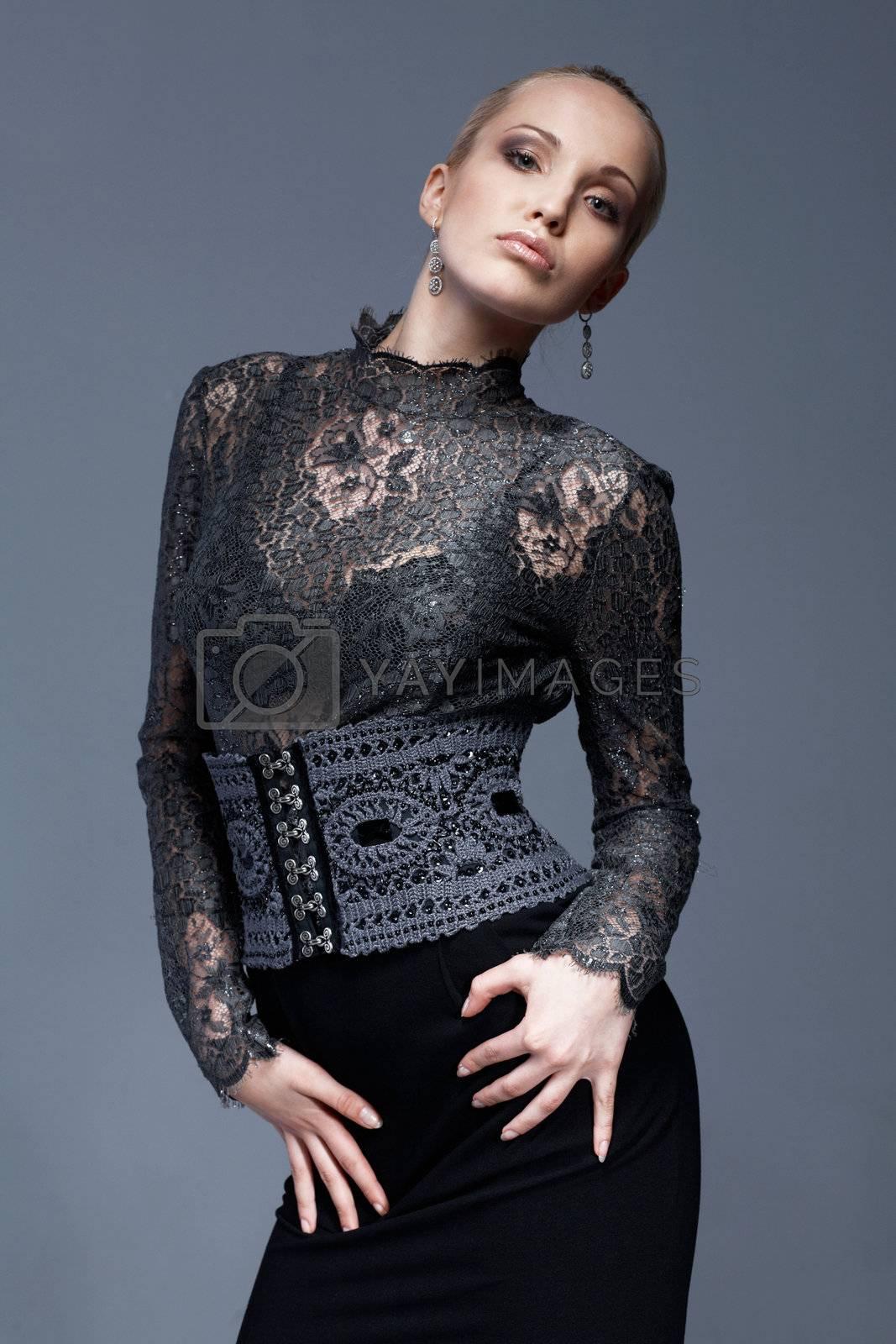 Portrait of a beautiful model in black, lace blouse, posing.