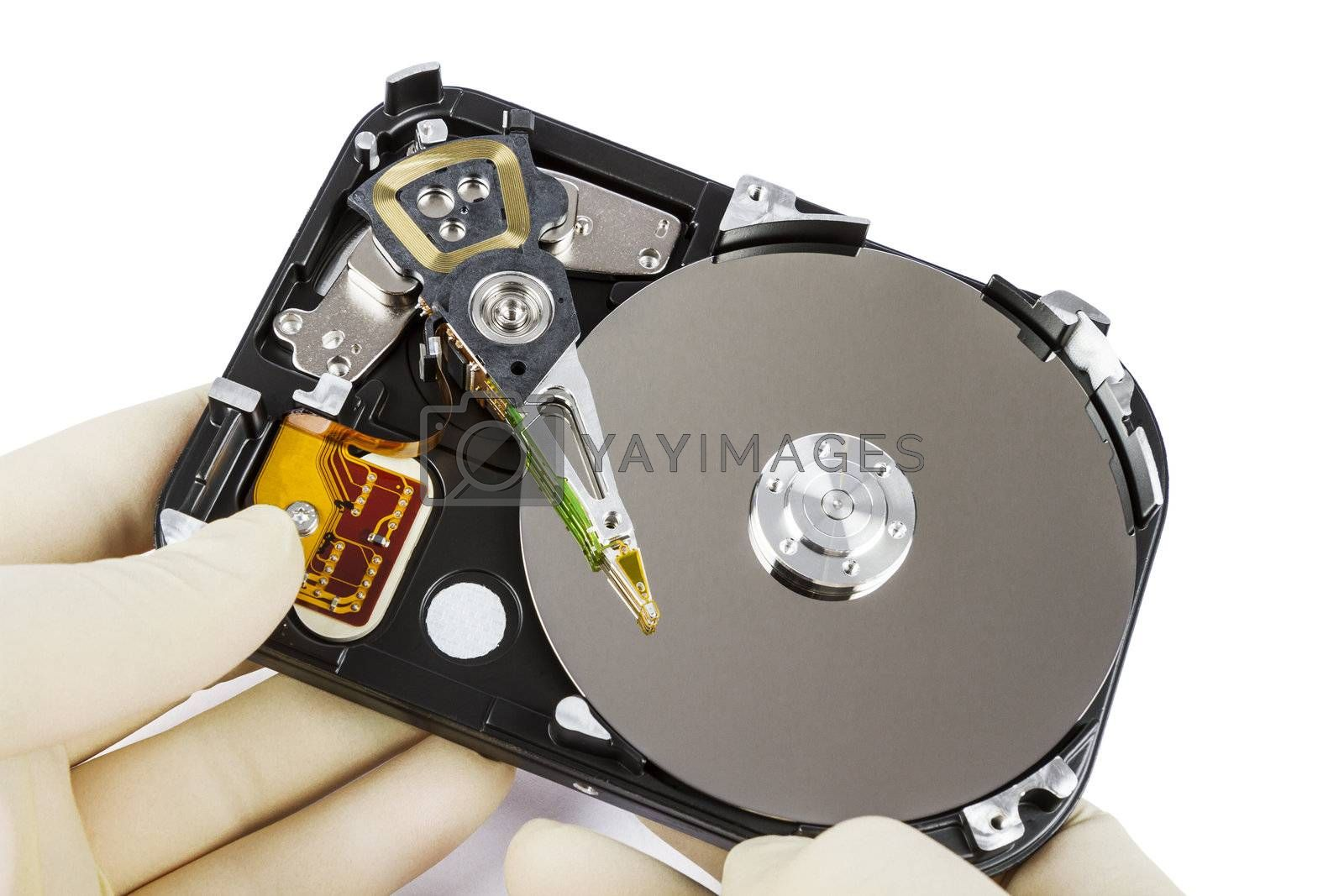 technician with open hard-disk in light background