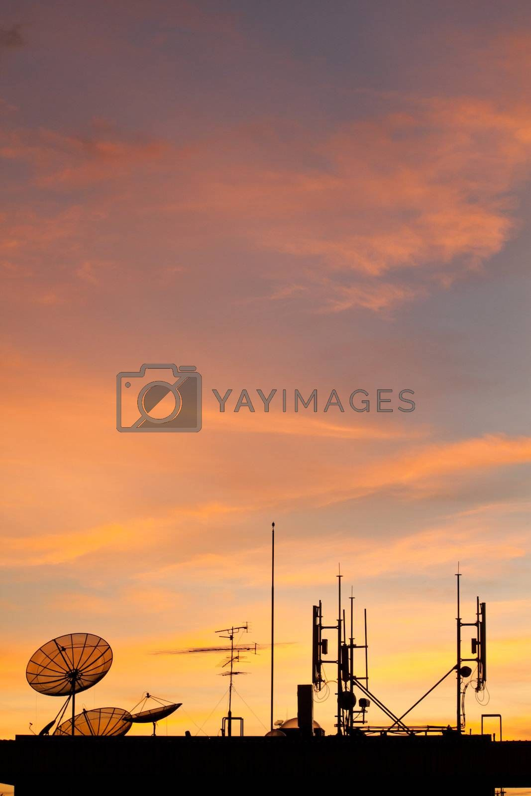 Worldwide Communication,  Satellite and other antenna network against beautiful sky at sunset